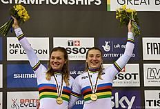 Gold medallists Russia's Daria Shmeleva and Russia's Anastasiia Voinova pose on the podium after the Women's team sprint final during the 2016 Track Cycling World Championships at the Lee Valley VeloPark in London on March 3, 2016 / AFP / Eric FEFERBERG