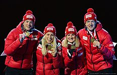 (L-R) Norway's Tarjei Boe, Tirli Eckhoff, Marte Olsbu and Johannes Thingnes Boe celebrate with their Bronze Medals at the medals ceremony after the 2x6 + 2x7,5 mixed relay event at the IBU World Championships Biathlon competition in Holmenkollen Arena in Oslo, Norway on March 3, 2016. nThe French team won the event ahead of Germany and Norway. / AFP / JONATHAN NACKSTRAND