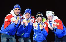 (L-R) Martin Fourcade, Quentin Fillon Maillet, Marie Dorin Habert and Anais Bescond of France celebrate with their Gold Medals at the medals ceremony after the 2x6 + 2x7,5 mixed relay event at the IBU World Championships Biathlon competition in Holmenkollen Arena in Oslo, Norway on March 3, 2016. nThe French team won the event ahead of Germany and Norway. / AFP / JONATHAN NACKSTRAND