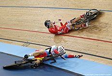 Russia's Anastasiia Voinova (L) crashes into Hong Kong's Sze Wai Lee on the finish line of the Women's Keirin qualification during the 2016 Track Cycling World Championships at the Lee Valley VeloPark in London on March 3, 2016 / AFP / ADRIAN DENNIS