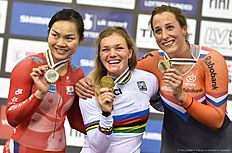 Silver medallist Hong Kong's Wai Sze Lee, gold medallist Russia's Anastasiia Voinova and bronze Netherland's Elis Ligtlee stand on the podium after the Women's 500m time trial final during the 2016 Track Cycling World Championships at the Lee Valley VeloPark in London on March 4, 2016. / AFP / Eric FEFERBERG