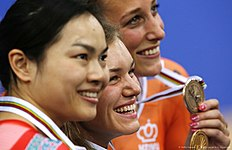 (L-R) Silver medallist Hong Kong's Wai Sze Lee, gold medallist Russia's Anastasiia Voinova and bronze Netherland's Elis Ligtlee stand on the podium after the Women's 500m time trial final during the 2016 Track Cycling World Championships at the Lee Valley VeloPark in London on March 4, 2016. / AFP / ADRIAN DENNIS