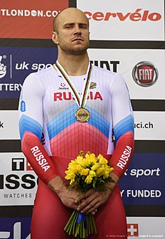 Bronze medallist Russia's Denis Dmitriev stands on the podium after the Men's Sprint finals during the 2016 Track Cycling World Championships at the Lee Valley VeloPark in London on March 5, 2016. / AFP / Eric FEFERBERG