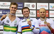(L-R) Silver medallist Australia's Matthew Glaetzer, Gold medallist Britain's Kenny Jason and bronze medallist Russia's Denis Dmitriev stand on the podium after the Men's Sprint finals during the 2016 Track Cycling World Championships at the Lee Valley VeloPark in London on March 5, 2016. / AFP / Eric FEFERBERG