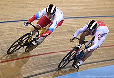 Russia's Denis Dmitriev (L) races Poland's Damian Zielinski in the Men's Sprint finals during the 2016 Track Cycling World Championships at the Lee Valley VeloPark in London on March 5, 2016. / AFP / Eric FEFERBERG
