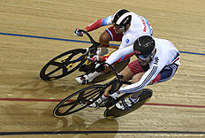 Russia's Denis Dmitriev (top) beats Britain's Callum Skinner in the Men's Sprint quarterfinals during the 2016 Track Cycling World Championships at the Lee Valley VeloPark in London on March 5, 2016. / AFP / Eric FEFERBERG