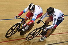 Russia's Denis Dmitriev (L) races Britain's Callum Skinner in the Men's Sprint quarterfinals during the 2016 Track Cycling World Championships at the Lee Valley VeloPark in London on March 5, 2016. / AFP / Eric FEFERBERG