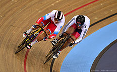 LONDON, ENGLAND — MARCH 05: Denis Dmitriev of Russia (L) competes against Callum Skinner of Great Britain in the Men's Sprint Quarter Finals during Day Four of the UCI Track Cycling World Championships at Lee Valley Velopark Velodrome on March 5, 2016 in London, England.