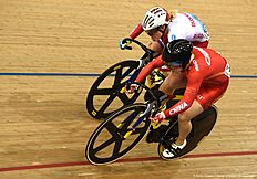 China's Lin Junhong (down) beats Russia's Anastasiia Voinova in the Women's Sprint last 8 round during the 2016 Track Cycling World Championships at the Lee Valley VeloPark in London on March 5, 2016. / AFP / Eric FEFERBERG