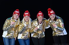 Norway's team celebrates during the medals ceremony after the Women 4 x 6 km Relay event at the IBU World Championships Biathlon competition in Oslo Holmenkollen, on March 11, 2016.nNorway won the event ahead of France (2nd) and Germany (3rd). / AFP / JONATHAN NACKSTRAND