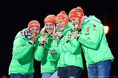 The German team make a selfie photo as they celebrates during the medals ceremony after the Women 4 x 6 km Relay event at the IBU World Championships Biathlon competition in Oslo Holmenkollen, on March 11, 2016.nNorway won the event ahead of France (2nd) and Germany (3rd). / AFP / JONATHAN NACKSTRAND