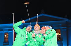 Germany's team makes a selfie photo during the medals ceremony after the Men 4 x 7,5 km Relay event at the IBU World Championships Biathlon competition in Oslo Holmenkollen, on March 12, 2016.nNorway won the event ahead of Germany (2nd) and Canada (3rd). / AFP / JONATHAN NACKSTRAND