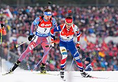 Norways Ole Einar Bjoerndalen (R) and Russias Anton Shipulin compete in the Men 15 km Mass Start event at the IBU World Championships Biathlon competition in Oslo Holmenkollen, on March 13, 2016. / AFP / JONATHAN NACKSTRAND