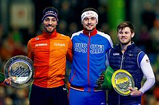 HEERENVEEN, NETHERLANDS — MARCH 13: Denisu00c2u00a0Yuskov (C) of Russia celebrates with the trophy after he wins the World Cup in the Men 1500m with Kjeldu00c2u00a0Nuis (L) of The Netherlands ( 2nd place) and Joeyu00c2u00a0Mantia (R) of the USA (3rd place) during day three of the ISU World Cup Speed Skating Finals held at Thialf Ice Arena on March 13, 2016 in Heerenveen, Netherlands. (Photo by Dean Mouhtaropoulos/Getty Images)