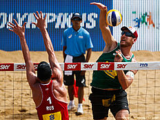 VITORIA, BRAZIL — MARCH 16: Alison Ceruti of Brazil spikes the ball against Nikita Liamin of Russia during the main draw match at Camburi beach during day two of the FIVB Beach Volleyball Vitoria Open, on March 16, 2016 in Vitoria, Brazil.