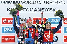 Winner Kaisa Makarainen of Finland, center, second placed Marie Dorin Habert of France, left, and third placed Dorothea Wierer of Italy celebrate on the podium at the end of the women's 10 km pursuit at the IBU World Championships Biathlon at Khanty-Mansiysk, 2759 km north-east of Moscow, Russia, Saturday, March 19, 2016. (AP Photo/Sergei Grits)