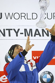 Martin Fourcade of France celebrates with his men's Overall World Cup Pursuit trophy during the award ceremony at the IBU World Championships Biathlon at Khanty-Mansiysk, 2759 km north-east of Moscow, Russia, Saturday, March 19, 2016. (AP Photo/Sergei Grits)
