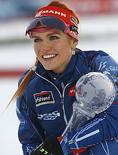 Gabriela Soukalova of Czech poses with her Women's Overall World Cup Pursuit trophy at the award ceremony at the IBU World Championships Biathlon at Khanty-Mansiysk, 2759 km north-east of Moscow, Russia, Saturday, March 19, 2016. (AP Photo/Sergei Grits)