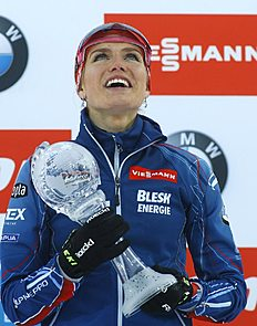 Czech Republic's Gabriela Soukalova poses with her Women's Overall World Cup Pursuit trophy at the award ceremony at the IBU World Championships Biathlon at Khanty-Mansiysk, 2759 km north-east of Moscow, Russia, Saturday, March 19, 2016. (AP Photo/Sergei Grits)