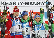 Winner Simon Schempp of Germany, center, second placed Johannes Thingnes Boe of Norway, left, and third placed Erik Lesser of Germany celebrate on the podium after the finish in the men's 12.5 km pursuit at the IBU World Championships Biathlon at Khanty-Mansiysk, 2759 km north-east of Moscow, Russia, Saturday, March 19, 2016. (AP Photo/Sergei Grits)