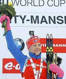 Winner Kaisa Makarainen of Finland celebrates on the podium at the end of the women's 10 km pursuit at the IBU World Championships Biathlon at Khanty-Mansiysk, 2759 km north-east of Moscow, Russia, Saturday, March 19, 2016. (AP Photo/Sergei Grits)