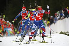 Kaia Woeien Nicolaisen of Norway, foreground, competes during the women's 10 km pursuit at the IBU World Championships Biathlon at Khanty-Mansiysk, 2759 km north-east of Moscow, Russia, Saturday, March 19, 2016. (AP Photo/Sergei Grits)