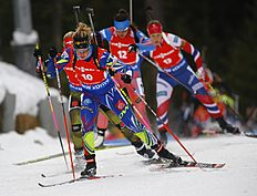 Second placed Marie Dorin Habert of France, foreground, competes during the women's 10 km pursuit at the IBU World Championships Biathlon at Khanty-Mansiysk, 2759 km north-east of Moscow, Russia, Saturday, March 19, 2016. (AP Photo/Sergei Grits)