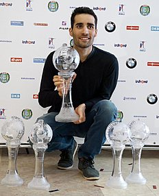 Martin Fourcade of France poses with his men's World Cup trophies during an award ceremony at the IBU World Championships Biathlon at Khanty-Mansiysk, 2759 km north-east of Moscow, Russia, Sunday, March 20, 2016. (AP Photo/Sergei Grits)