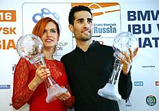 Martin Fourcade of France, right, and Gabriela Soukalova of the Czech Republic pose with their World Cup trophies during an award ceremony at the IBU World Championships Biathlon at Khanty-Mansiysk, 2759 km north-east of Moscow, Russia, Sunday, March 20, 2016. (AP Photo/Sergei Grits)
