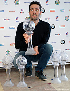 French Martin Fourcade poses with his Big Crystal Globe in the overall ranking, as well as four Small Crystal Globes in sprint, pursuit, mass start, and individual race at the 201516 Biathlon World Cup in Khanty-Mansiysk, Russia, on March 20, 2016. / AFP / EVGENY TUMASHOV
