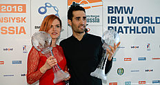 French Martin Fourcade (R) and Czech Gabriela Soukalova pose with their Big Crystal Globes in the overall ranking at the 201516 Biathlon World Cup in Khanty-Mansiysk, on March 20, 2016. A / AFP / EVGENY TUMASHOV