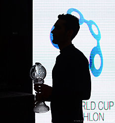 French Martin Fourcade holds his Big Crystal Globe in the overall ranking at the 201516 Biathlon World Cup in Khanty-Mansiysk, on March 20, 2016. / AFP / EVGENY TUMASHOV