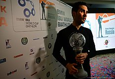 French Martin Fourcade poses with his Big Crystal Globe in the overall ranking at the 201516 Biathlon World Cup in Khanty-Mansiysk, on March 20, 2016. / AFP / EVGENY TUMASHOV