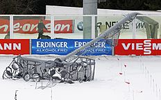 A lights post lays on the shooting range after strong winds, prior the women's 12,5 mass start at the IBU World Championships Biathlon at Khanty-Mansiysk, 2759 km north-east of Moscow, Russia, Sunday, March 20, 2016. All races � women's and men's mass start were cancelled. (AP Photo/Sergei Grits)