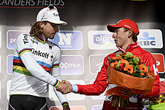 Slovakia's Peter Sagan of Tinkoff (L) shakes hands with Russia's Viacheslav Kuznetsov of Team Katusha as they celebrate on the podium after the 78th edition of the Gent-Wevelgem one day cycling race, on March 27, 2016 in Welvegem. / AFP / Belga / DIRK WAEM / Belgium OUT