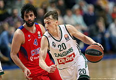 MOSCOW, RUSSIA — APRIL 01: Kaspars Vecvagars, #20 of Zalgiris Kaunas competes with Milos Teodosic, #4 of CSKA Moscow in action during the 2015-2016 Turkish Airlines Euroleague Basketball Top 16 Round 13 game between CSKA Moscow v Zalgiris Kaunas at Megasport Arena on April 1, 2016 in Moscow, Russia.