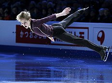 Mikhail Kolyada, of Russia, skates during the exhibition program фото (photo)