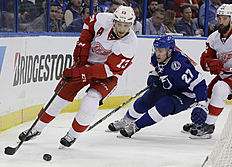Detroit Red Wings center Pavel Datsyuk (13), of Russia, skates ahead of Tampa Bay Lightning left wing Jonathan Drouin (27) during the second period of Game 2 in a first-round NHL hockey Stanley Cup playoff series Friday, April 15, 2016, in Tampa, Fla. (AP Photo/Chris O'Meara)