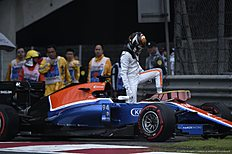 Manor F1 Team's German driver Pascal Wehrlein leaves his car after spinning out during qualifying for the Formula One Chinese Grand Prix in Shanghai on April 16, 2016. / AFP / WANG ZHAO