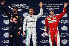 SHANGHAI, CHINA — APRIL 16: Top three qualifiers, Nico Rosberg of Germany and Mercedes GP, Daniel Ricciardo of Australia and Red Bull Racing and Kimi Raikkonen of Finland and Ferrari celebrate in parc ferme during qualifying for the Formula One Grand Prix of China at Shanghai International Circuit on April 16, 2016 in Shanghai, China.