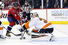RETRANSMISSION TO CORRECT TO GAME 2 INSTEAD OF GAME 1 � Washington Capitals left wing Alex Ovechkin (8), from Russia, works the puck against Philadelphia Flyers goalie Steve Mason (35) during the second period of Game 2 in the first round of the NHL Stanley Cup hockey playoffs, Saturday, April 16, 2016, in Washington. (AP Photo/Alex Brandon)