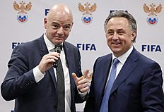 FIFA President Gianni Infantino, left, and Russian Sports Minister Vitaly Mutko speak at a news conference in Moscow, Russia, Tuesday, April 19, 2016. Infantino defended Russia's human rights record on Tuesday in his first visit to the 2018 World Cup host nation since taking charge of soccer's governing body, saying the country was �open and welcoming.� (AP Photo/Alexander Zemlianichenko)