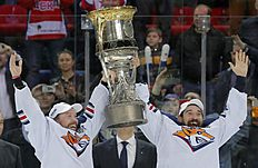 Ice Hockey — CSKA Moscow v Metallurg Magnitogorsk — Kontinental Hockey League — Gagarin Cup Grand Final, awarding ceremony — Moscow, Russia — 19/04/16 Metallurg Magnitogorsk's Sergei Mozyakin and Danis Zaripov lift the trophy as they celebrate winning the Gagarin Cup. REUTERS/Maxim Shemetov