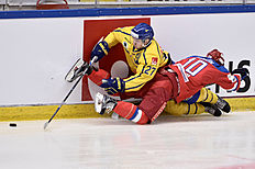 Ice Hockey — Sweden v Russia — Euro Hockey Tour — Sodertalje, Sweden — 21/4/16. Sweden's Pathrik Westerholm (L) and Russia's Vladimir Galuzin (R) during the Euro Hockey Tour match. TT News Agency/Claudio Bresciani/via REUTERSATTENTION EDITORS — THIS IMAGE WAS PROVIDED BY A THIRD PARTY. FOR EDITORIAL USE ONLY. SWEDEN OUT. NO COMMERCIAL OR EDITORIAL SALES IN SWEDEN. NO COMMERCIAL SALES.