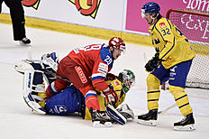 Ice Hockey � Sweden v Russia � Euro Hockey Tour � Sodertalje, Sweden � 21/4/16. Russiau00e2u0080u0099s Egor Averin (L) sits on Sweden's Jacob Markstru00c3u00b6m (C) in front of Magnus Nygren during the Euro Hockey Tour match. TT News Agency/Claudio Bresciani/via REUTERSATTENTION EDITORS � THIS IMAGE WAS PROVIDED BY A THIRD PARTY. FOR EDITORIAL USE ONLY. SWEDEN OUT. NO COMMERCIAL OR EDITORIAL SALES IN SWEDEN. NO COMMERCIAL SALES.