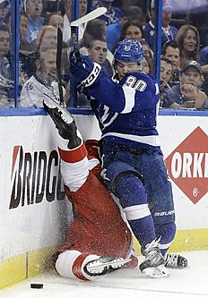 Tampa Bay Lightning center Vladislav Namestnikov (90), of Russia, upends Detroit Red Wings defenseman Brendan Smith as they chase the puck during the second period of Game 5 in a first-round NHL hockey Stanley Cup playoff series Thursday, April 21, 2016, in Tampa, Fla. (AP Photo/Chris O'Meara)