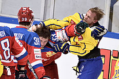Ice Hockey — Sweden v Russia — Euro Hockey Tour — Sodertalje, Sweden — 21/4/16. Russia's Albert Yarullin (R) and Sweden's Patrick Cehlin (L) fight during the Euro Hockey Tour match. TT News Agency/Claudio Bresciani/via REUTERSATTENTION EDITORS — THIS IMAGE WAS PROVIDED BY A THIRD PARTY. FOR EDITORIAL USE ONLY. SWEDEN OUT. NO COMMERCIAL OR EDITORIAL SALES IN SWEDEN. NO COMMERCIAL SALES. TPX IMAGES OF THE DAY
