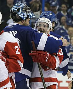 Detroit Red Wings center Pavel Datsyuk, right, of Russia, hugs Tampa Bay Lightning goalie Ben Bishop after the Lightning defeated the Red Wings 1-0 during Game 5 in a first-round NHL hockey Stanley Cup playoff series Thursday, April 21, 2016, in Tampa, Fla. (AP Photo/Chris O'Meara)
