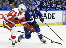 Detroit Red Wings center Pavel Datsyuk (13), of Russia, knocks the puck away from Tampa Bay Lightning left wing Jonathan Drouin (27) during the second period of Game 5 in a first-round NHL hockey Stanley Cup playoff series Thursday, April 21, 2016, in Tampa, Fla. (AP Photo/Chris O'Meara)