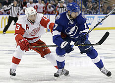 Detroit Red Wings center Pavel Datsyuk (13), of Russia, gets his stick around Tampa Bay Lightning center Alex Killorn (17) during the second period of Game 5 in a first-round NHL hockey Stanley Cup playoff series Thursday, April 21, 2016, in Tampa, Fla. (AP Photo/Chris O'Meara)